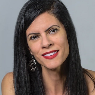 Marte Andrade, Creative Conductor helping small business owners with branding and marketing their business.